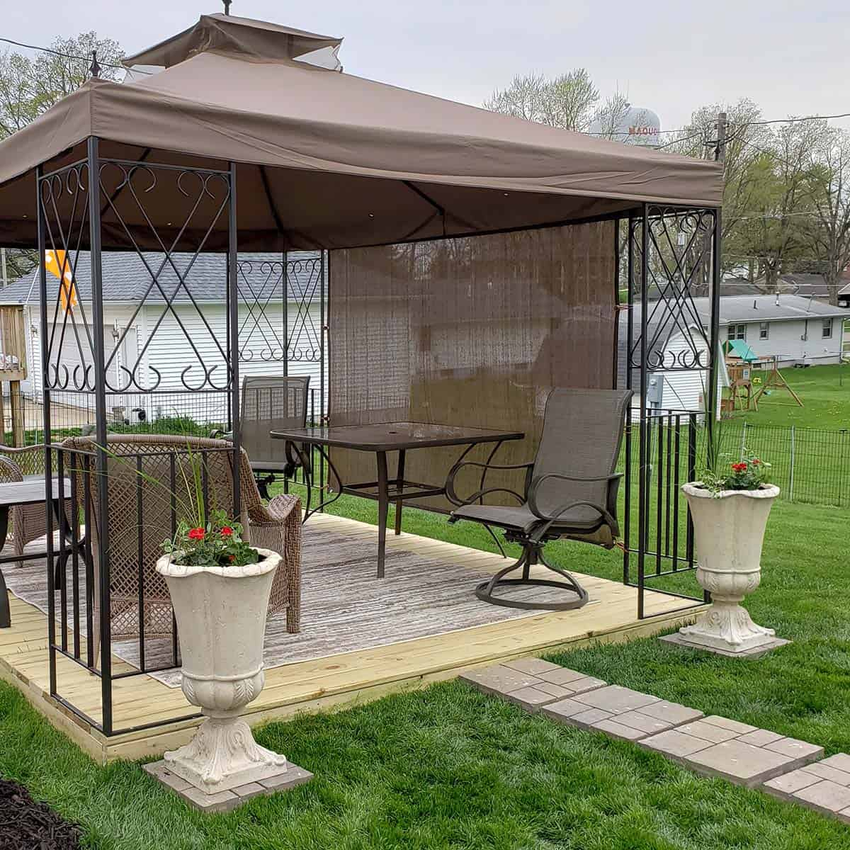 Gazebo with brick pavers and flowers