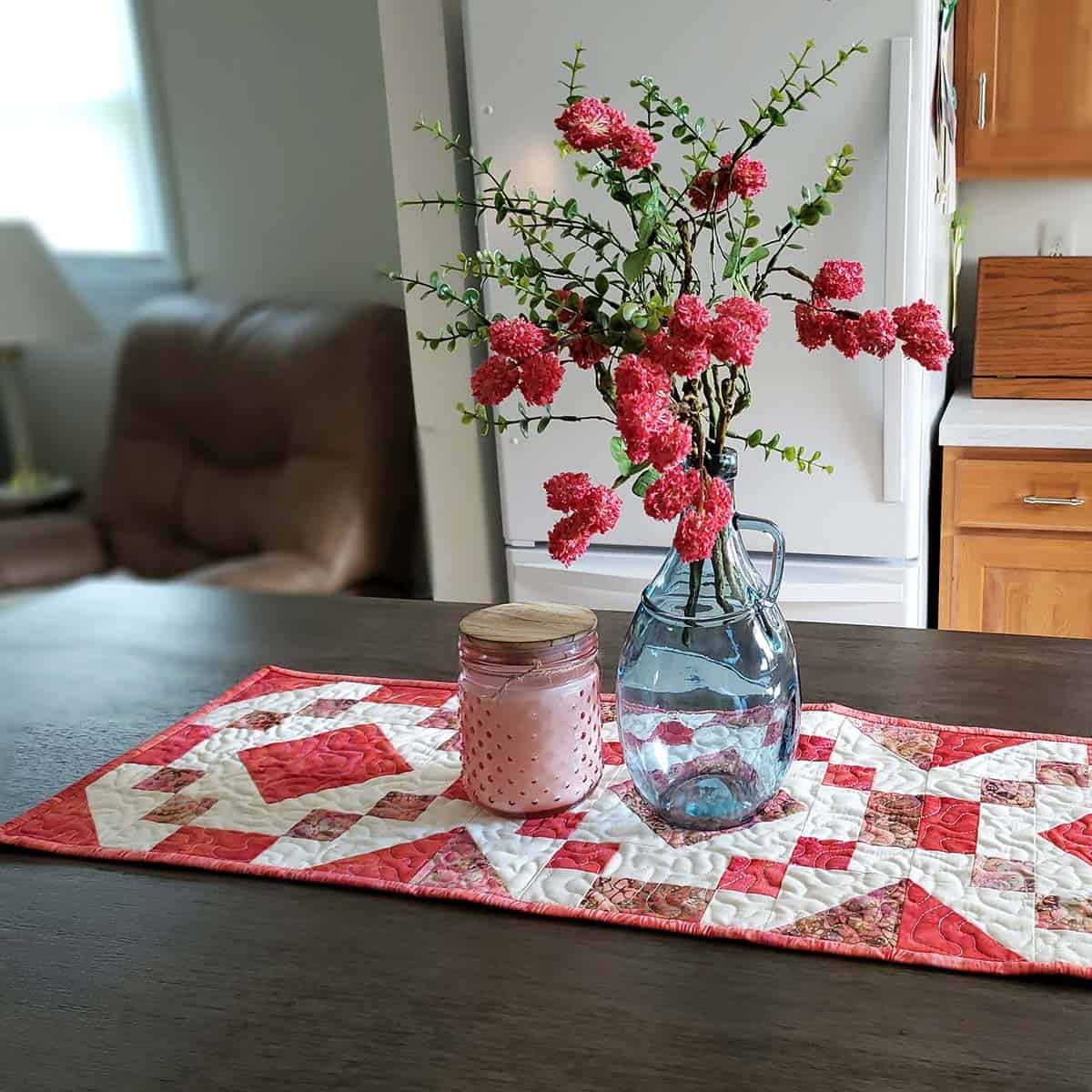 vase of flowers on quilted table runner