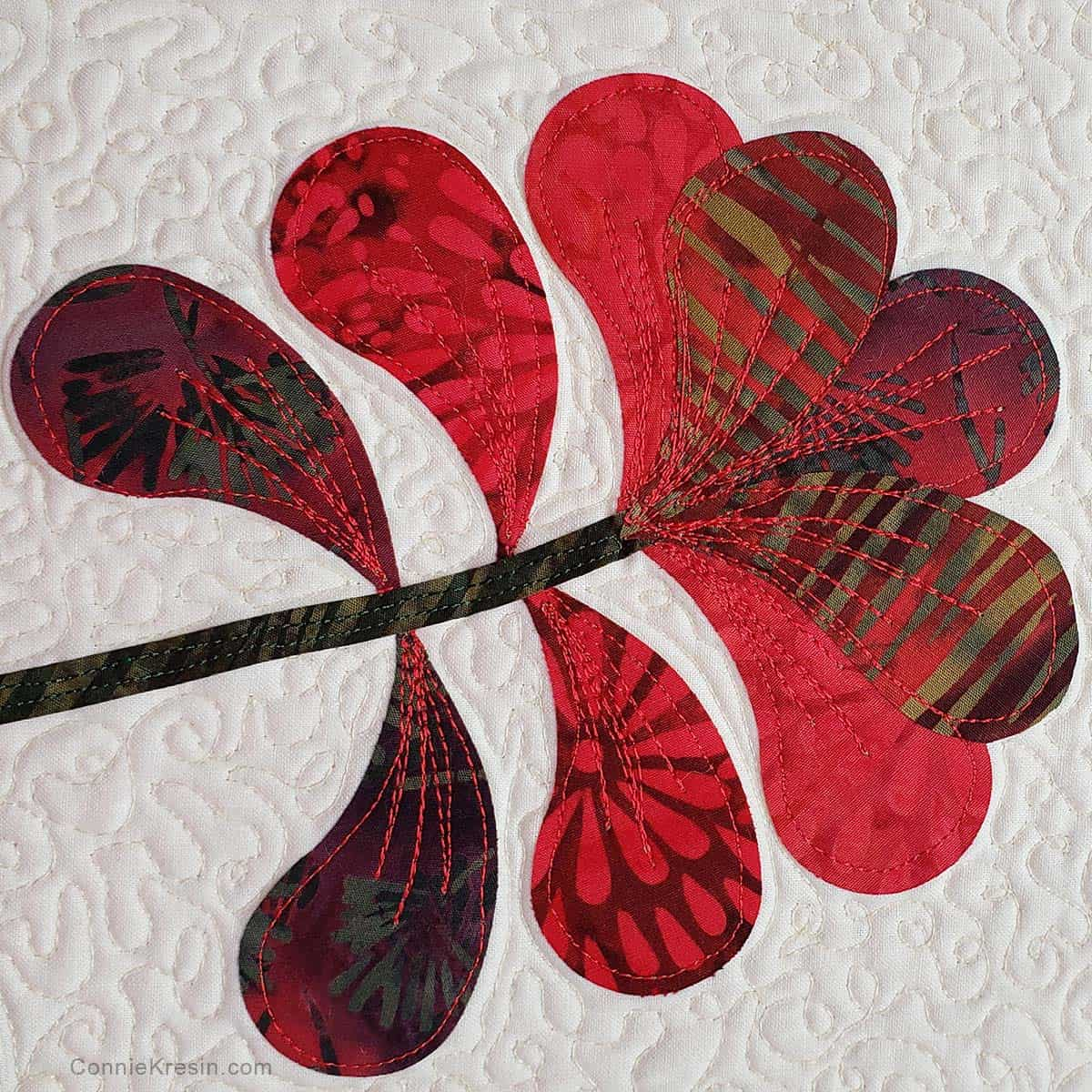 Thread painting on the fabric flowers