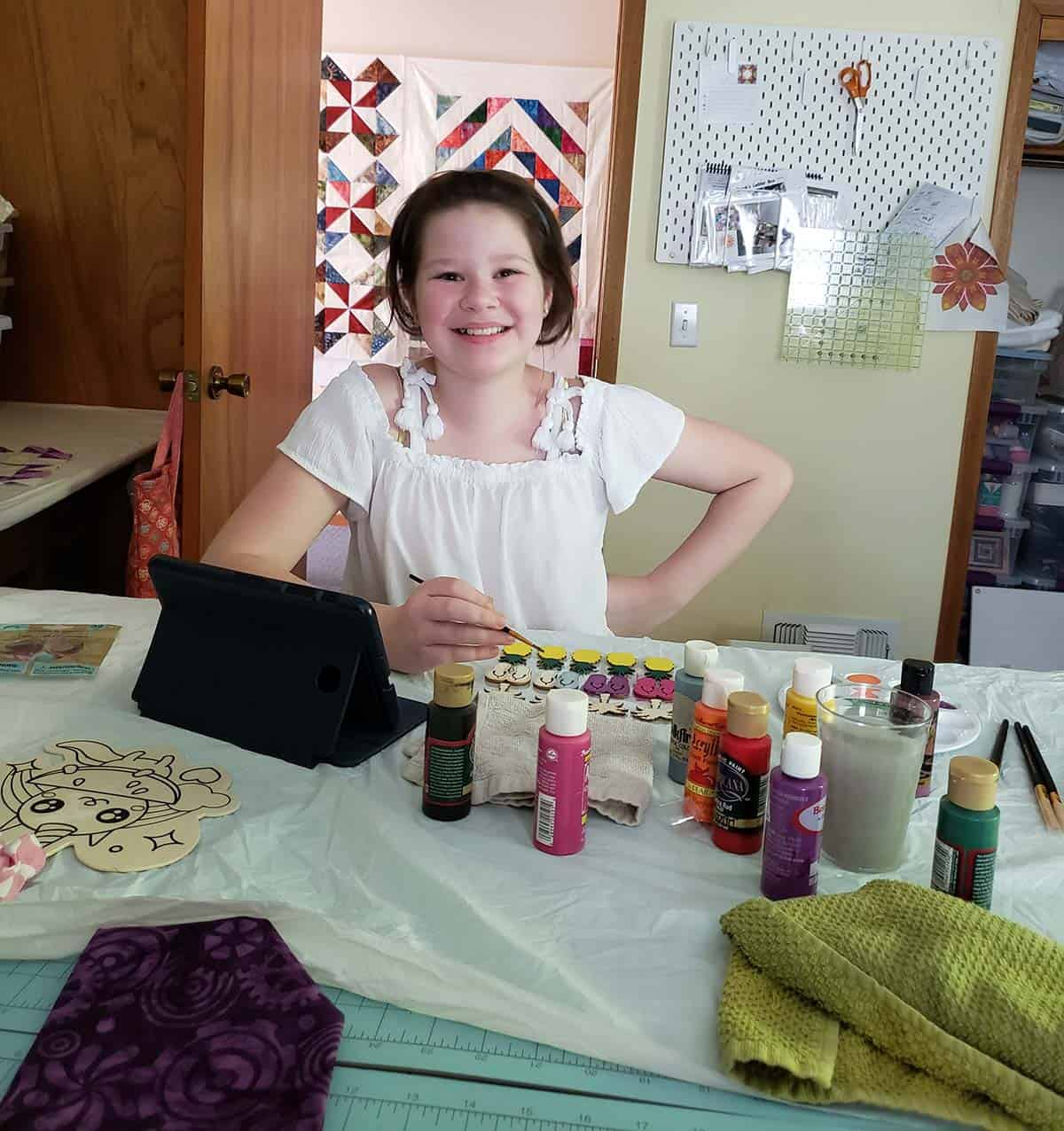 Granddaughter painting and doing crafts