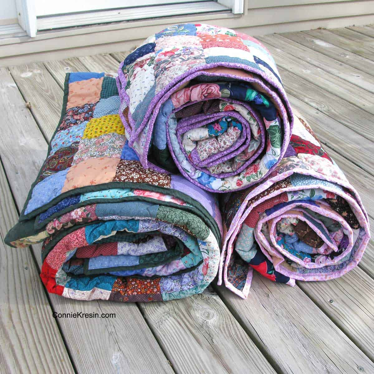Added binding to the scrappy quilts