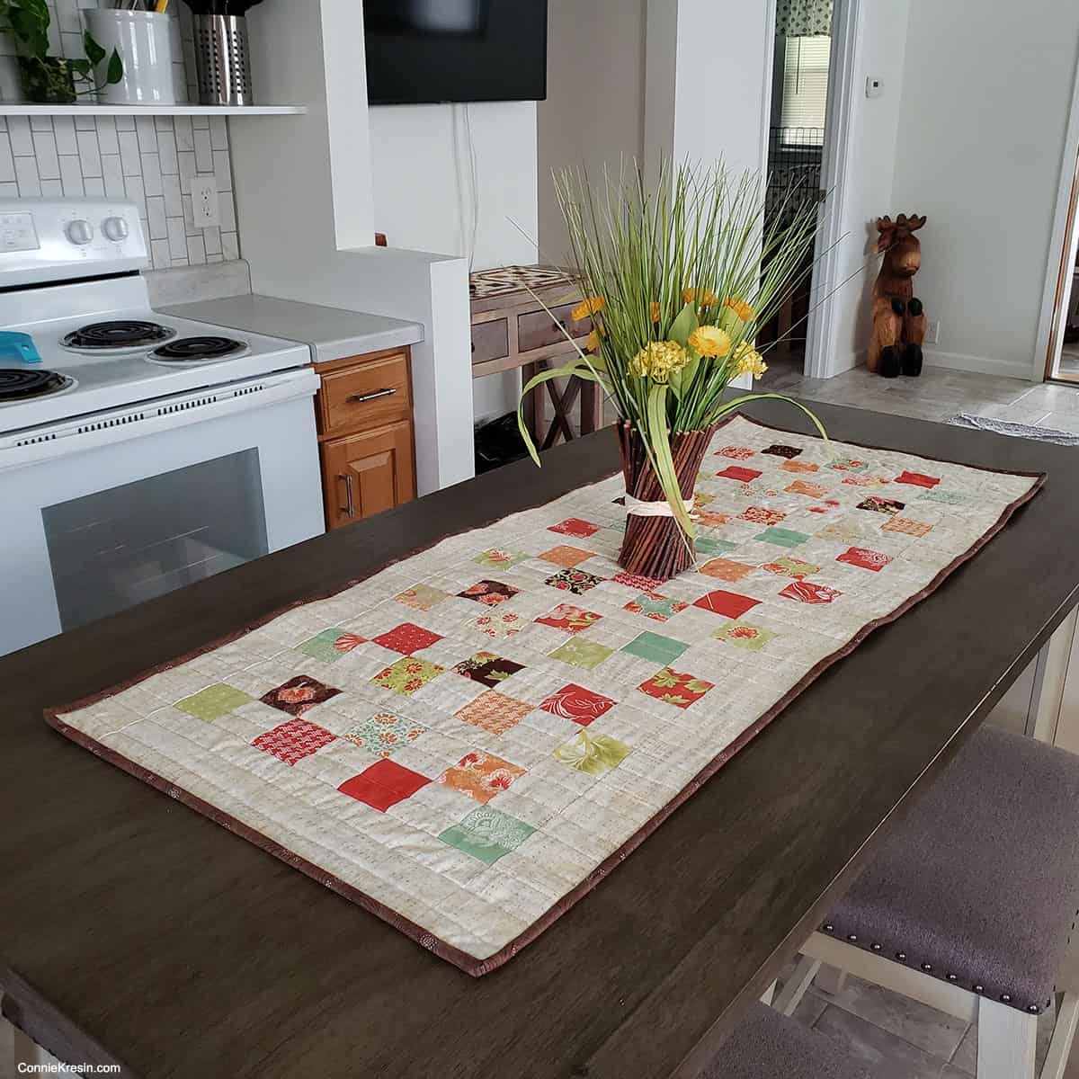 quilted table runner on kitchen table