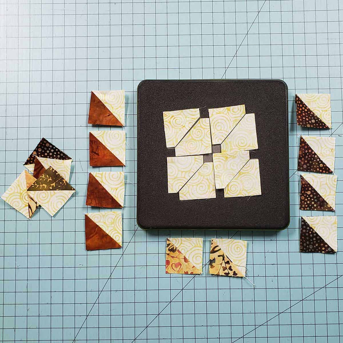Qurtis half square triangles with AccuQuilt cutter