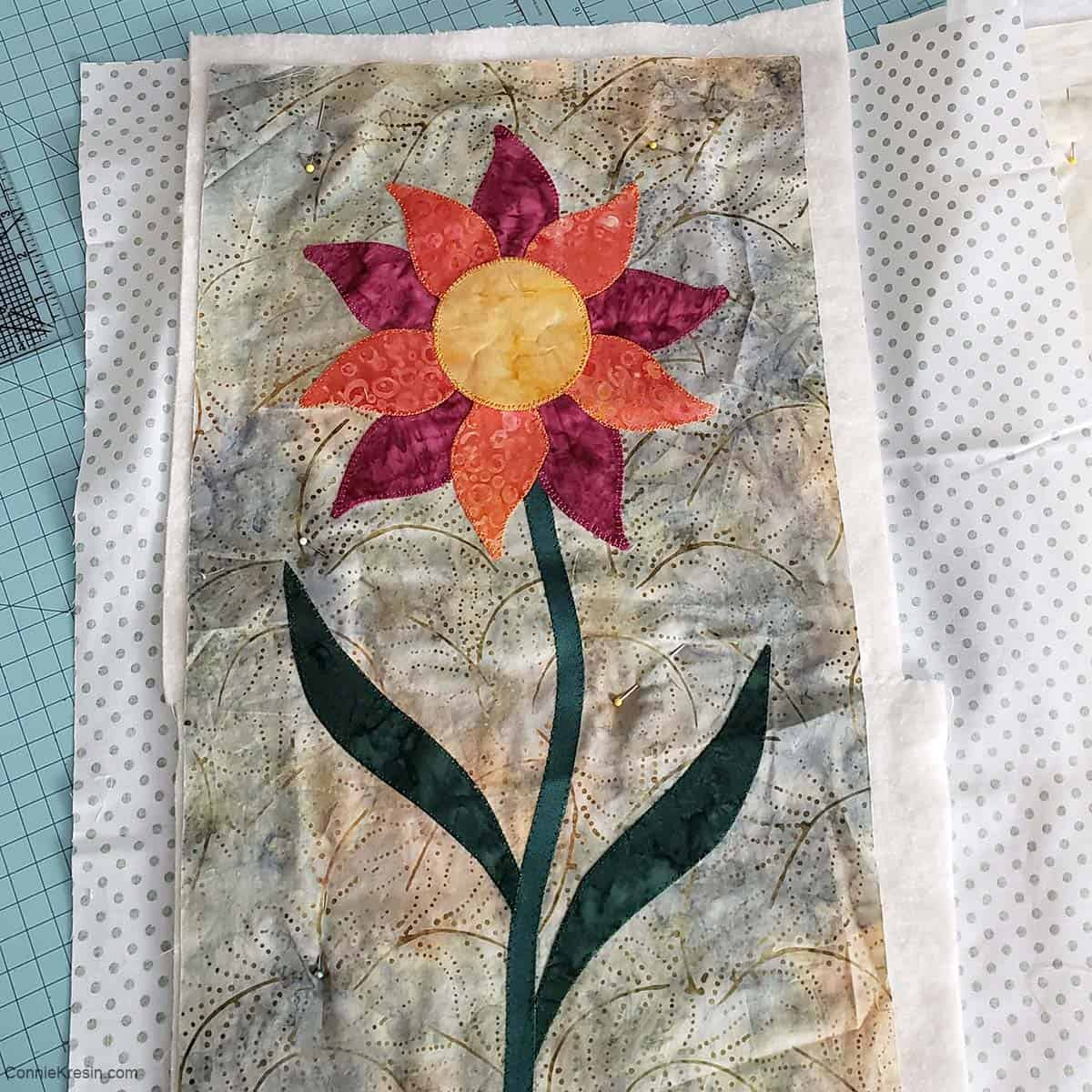 Tall flower with button hole applique