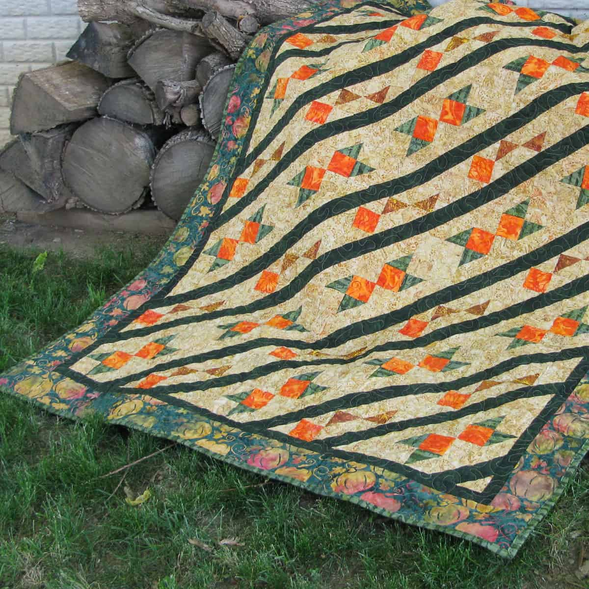 Arrowhead quilt on woodpile