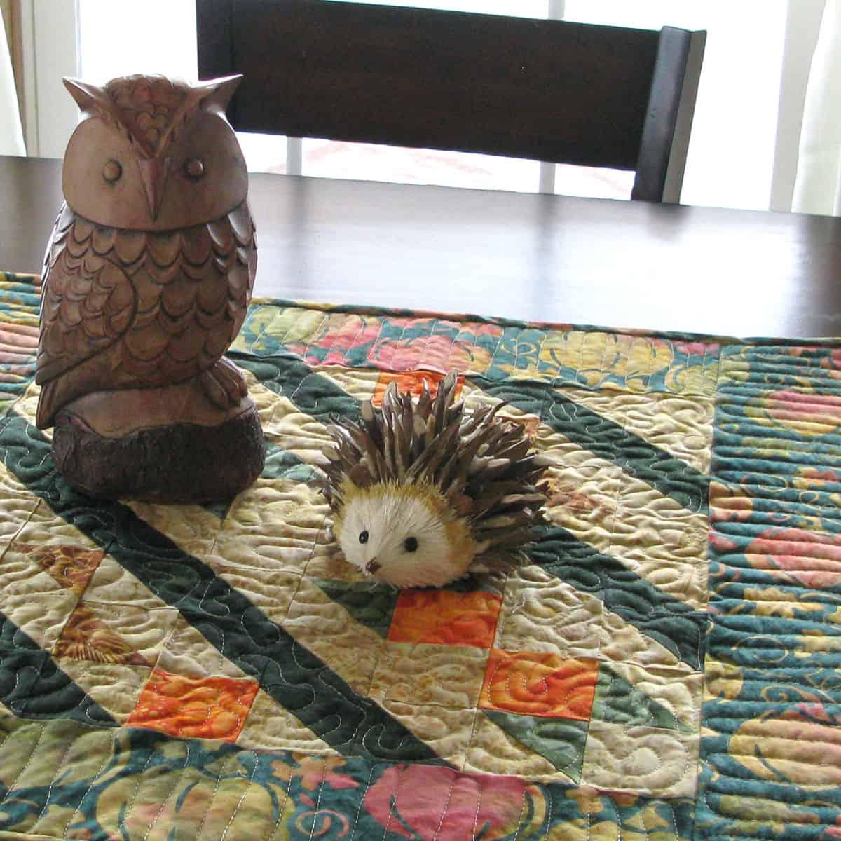 Arrowhead table topper with owl
