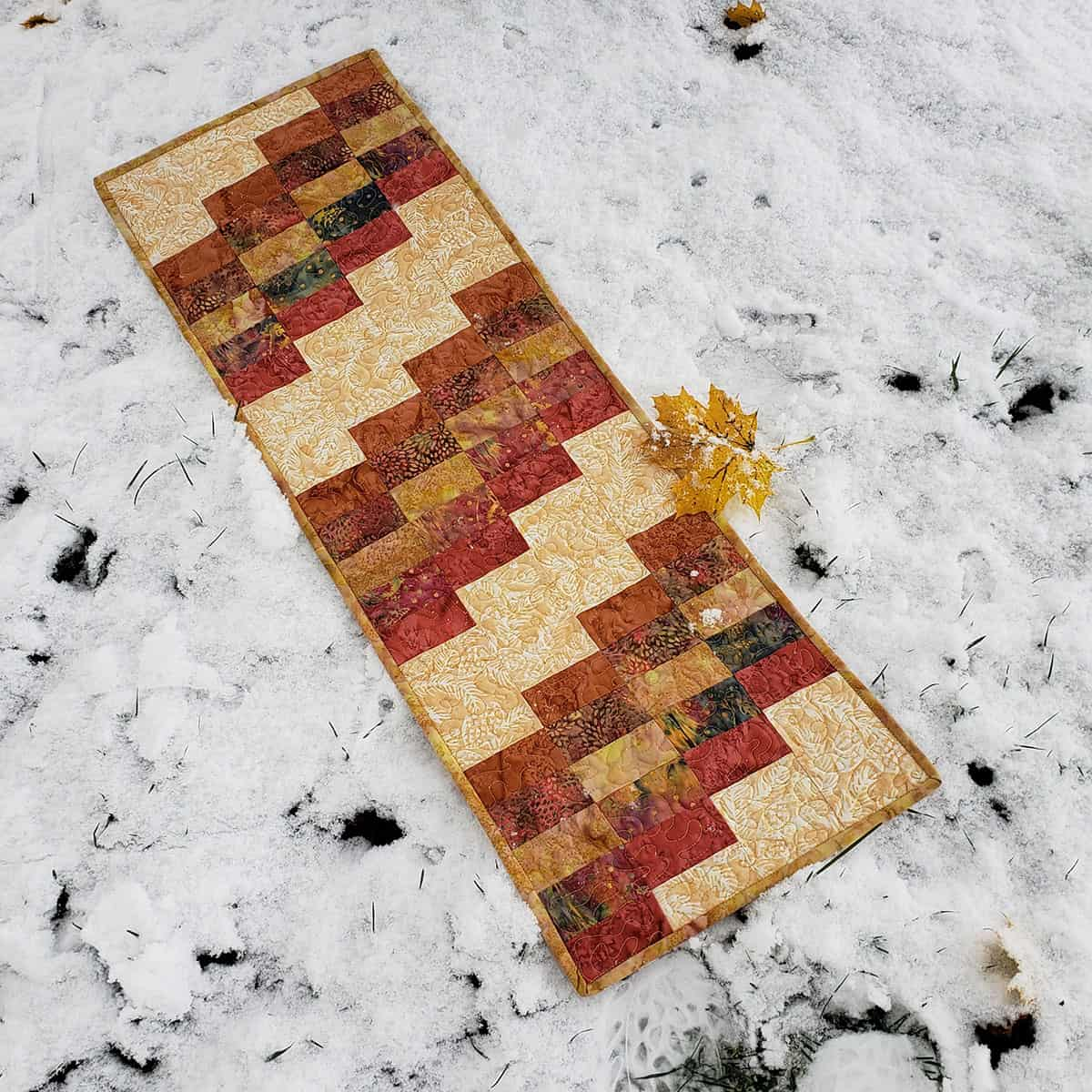 Autumn table runner in the snow