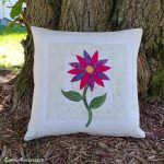 Appliqued batik quilted pillow