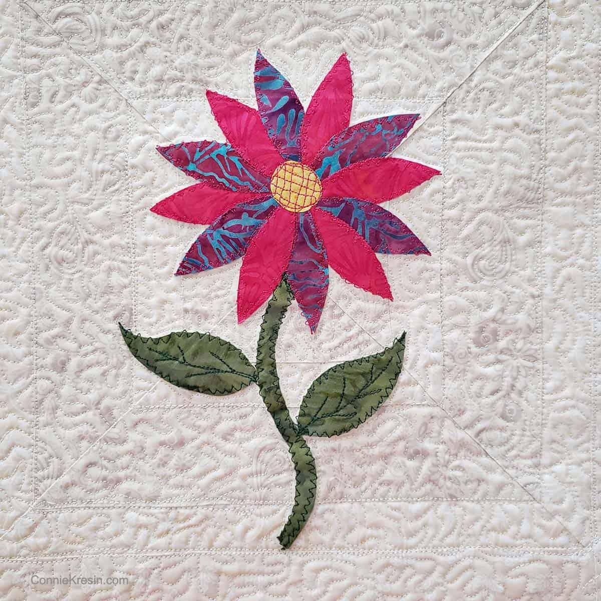 Closeup of the appliqued flower design