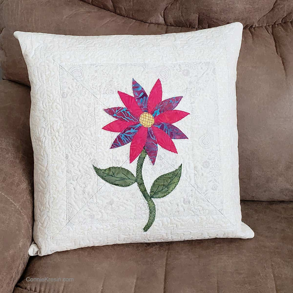 Appliqued flower pillow on couch
