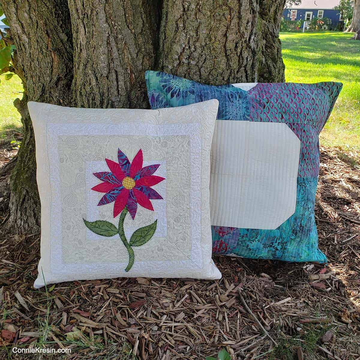 Quilted pillows by tree
