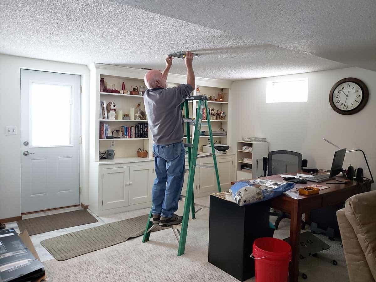Builder Bob installing new lights