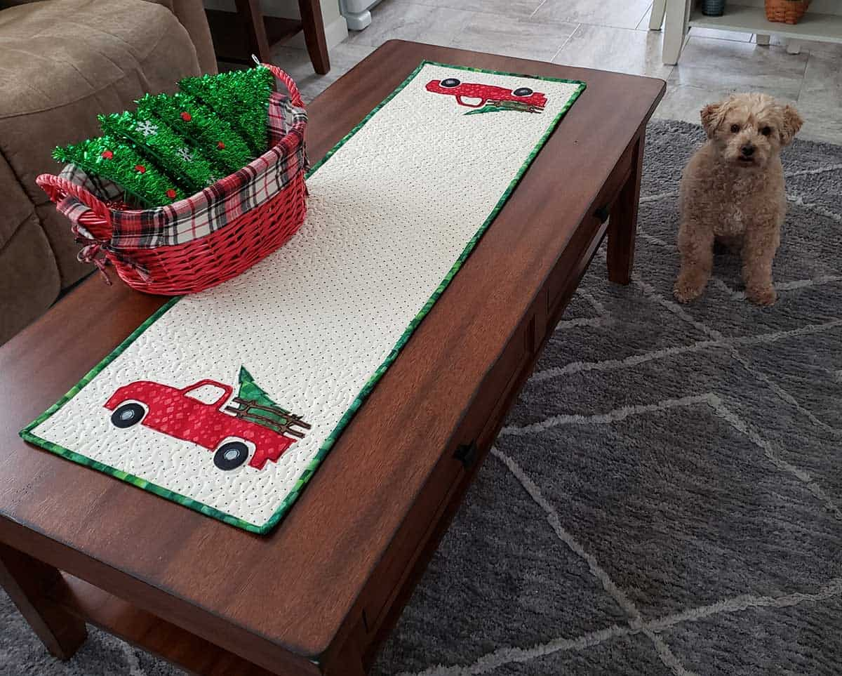 Christmas truck table runner and Mickey the dog