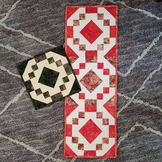 Finished coral jewel table runner on rug