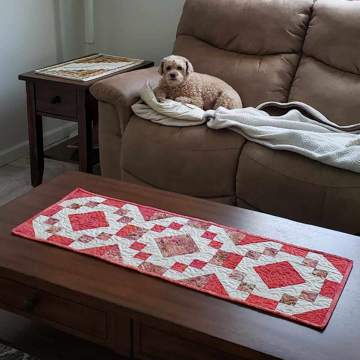 Mickey the poodle on the couch by the table runner