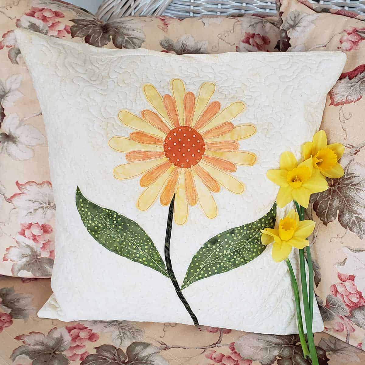 Daisy pillow and daffodils