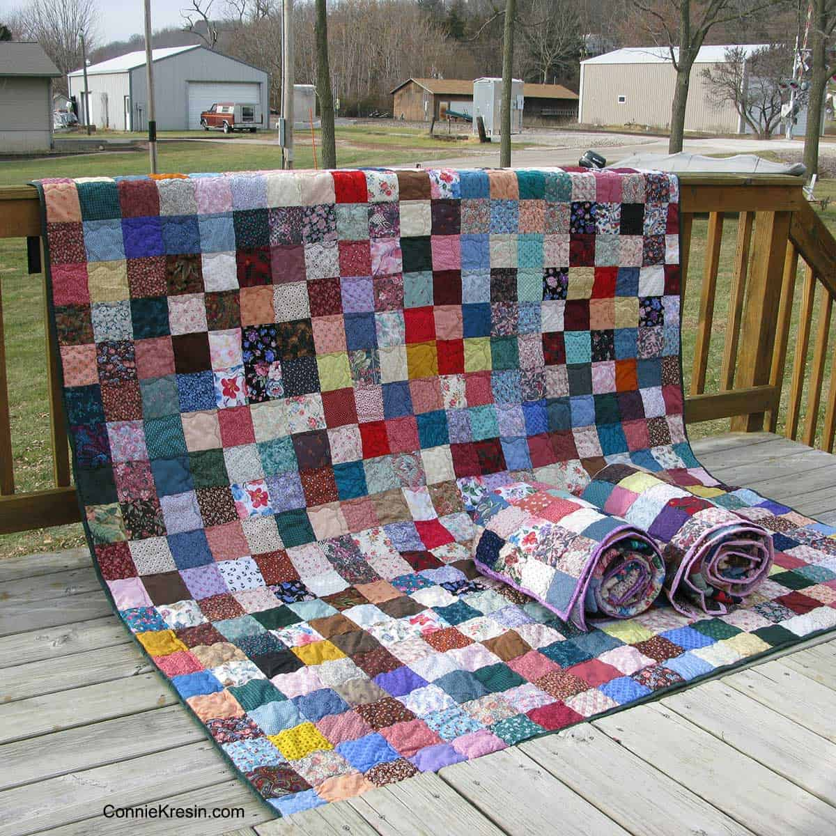 Fast & Easy Scrappy Quilt on deck rail