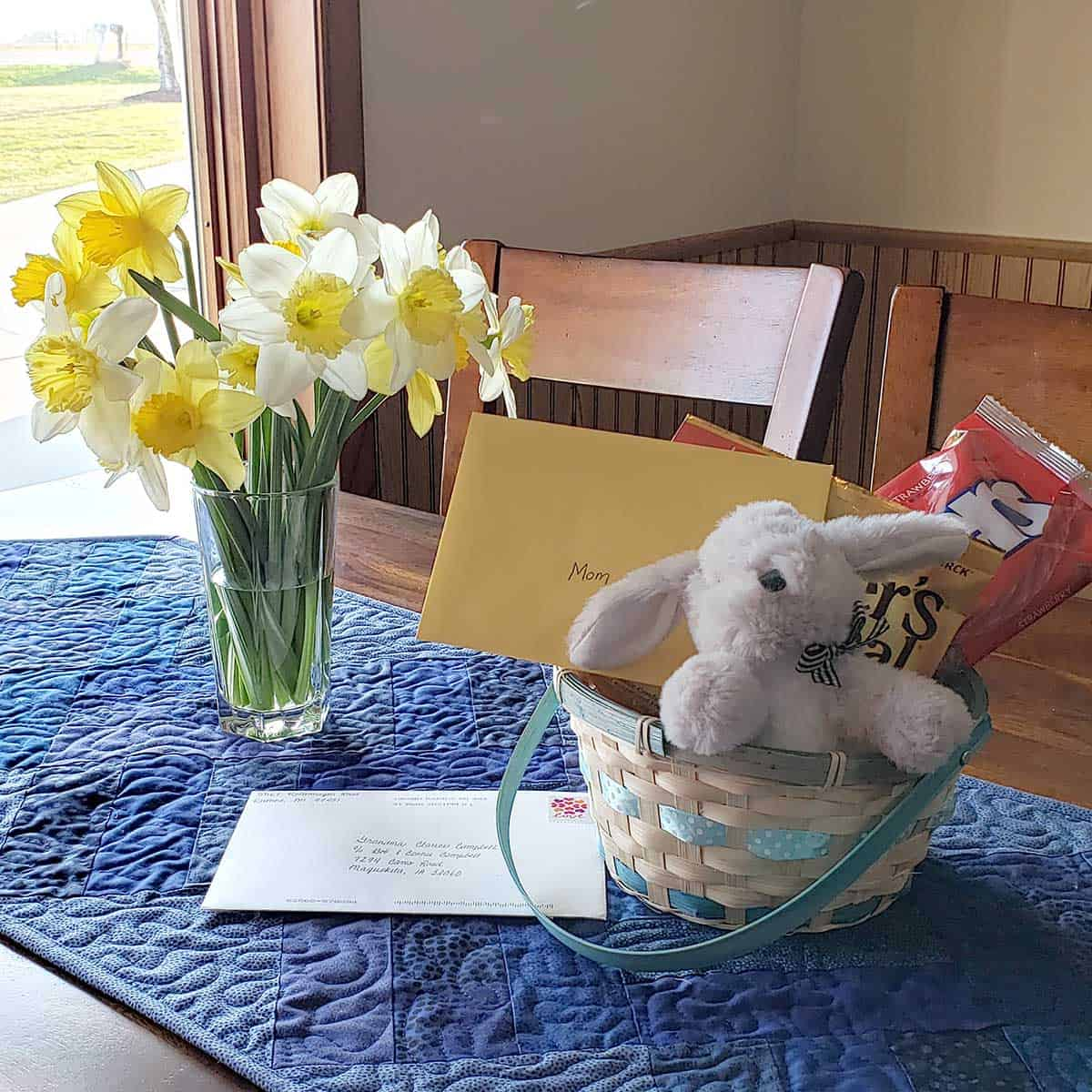 Flowers and Easter Basket on table