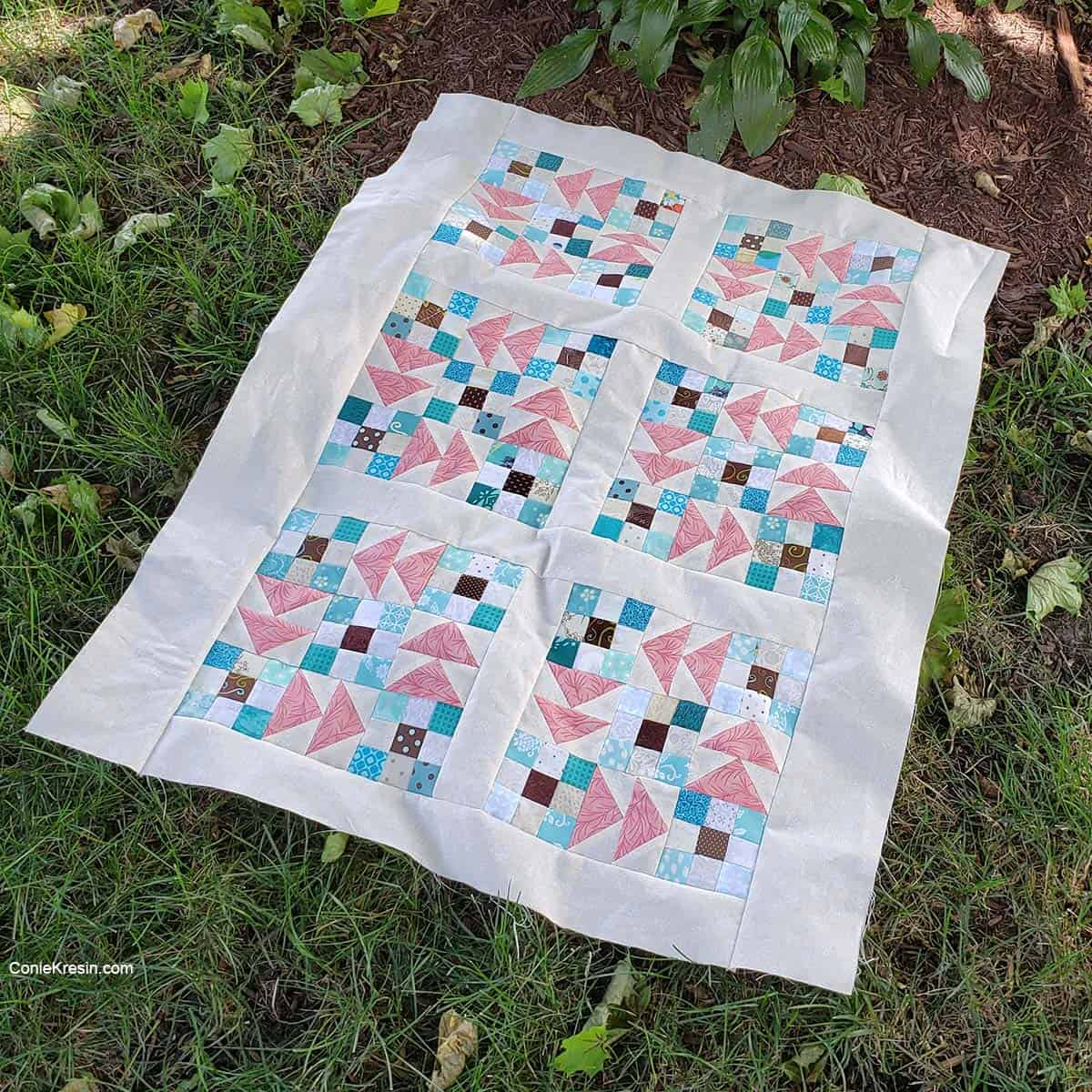 Flying 9-patch baby quilt