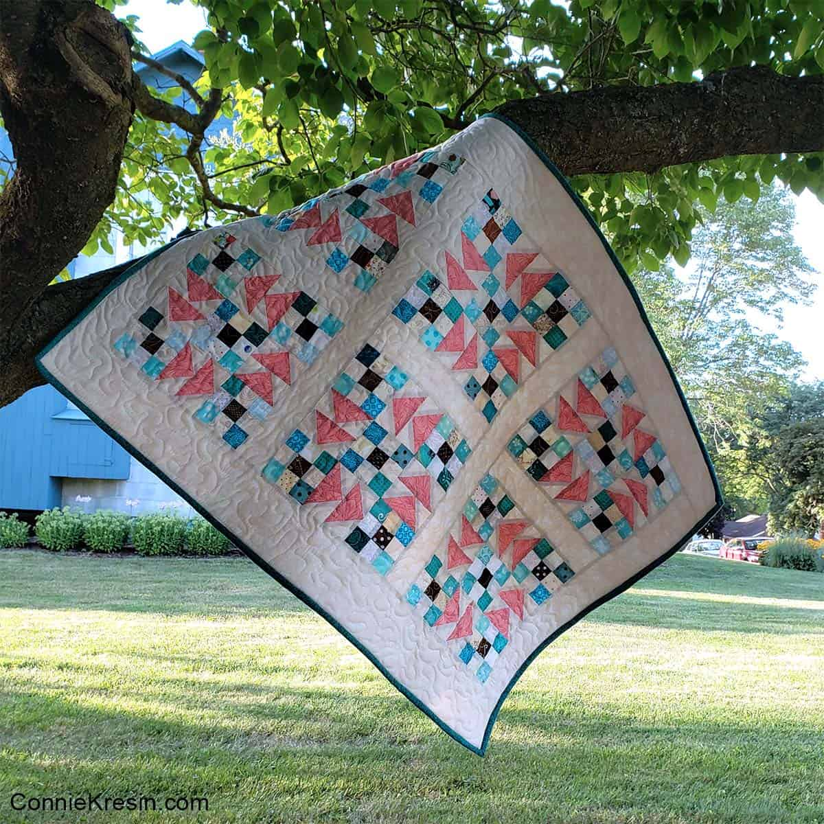 Flying Nines baby quilt hanging in tree