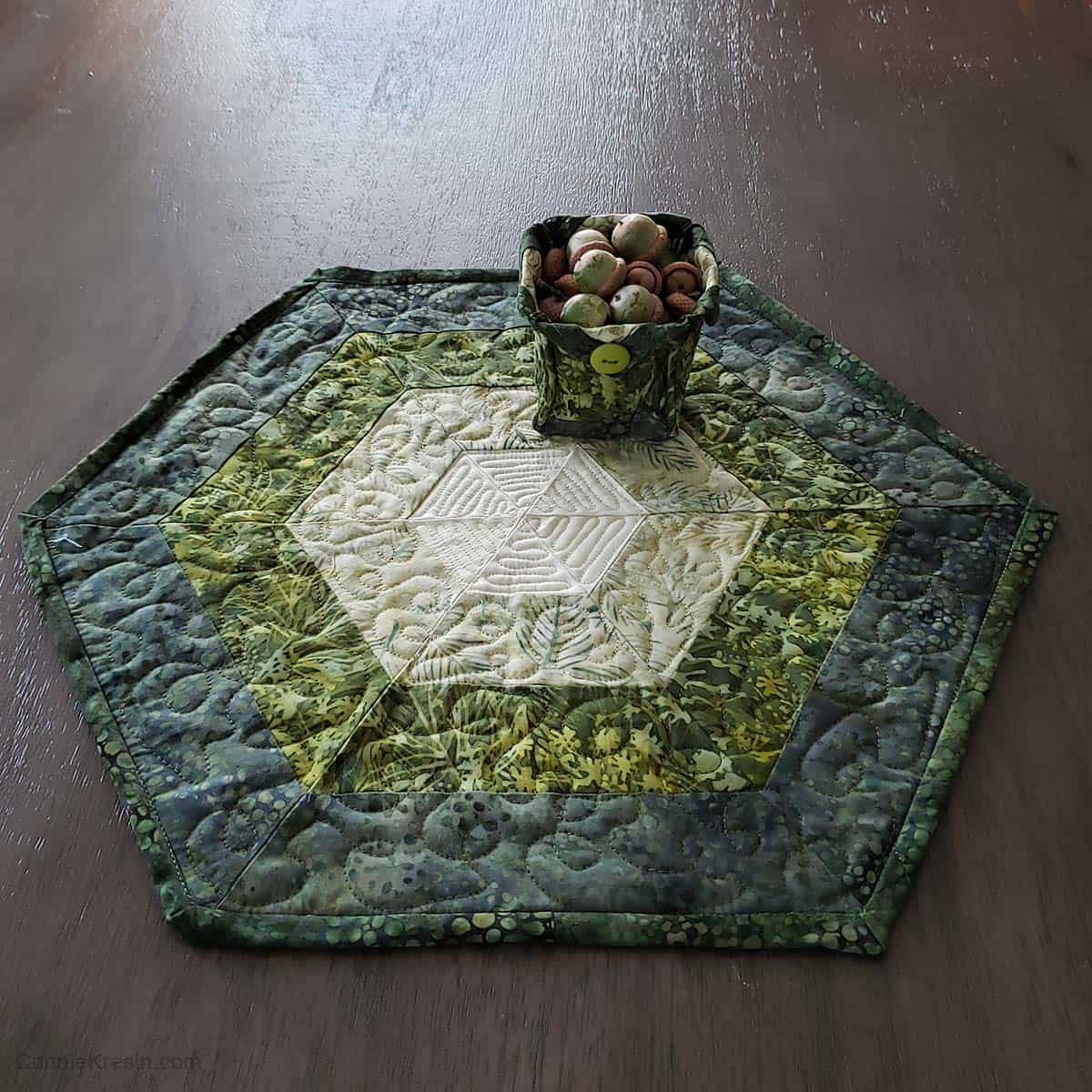 Green batik table topper and small fabric basket