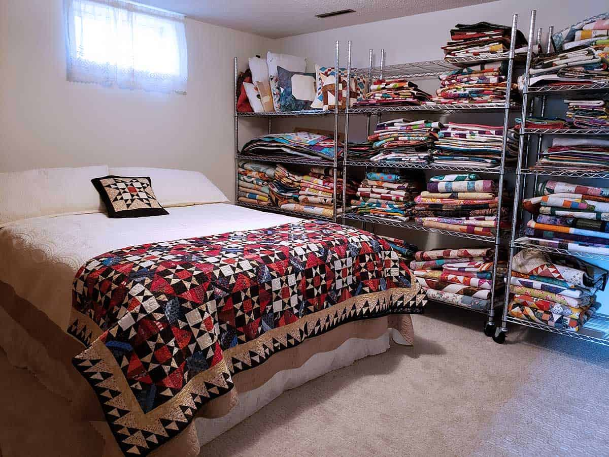 Guest bedroom with lots of quilts