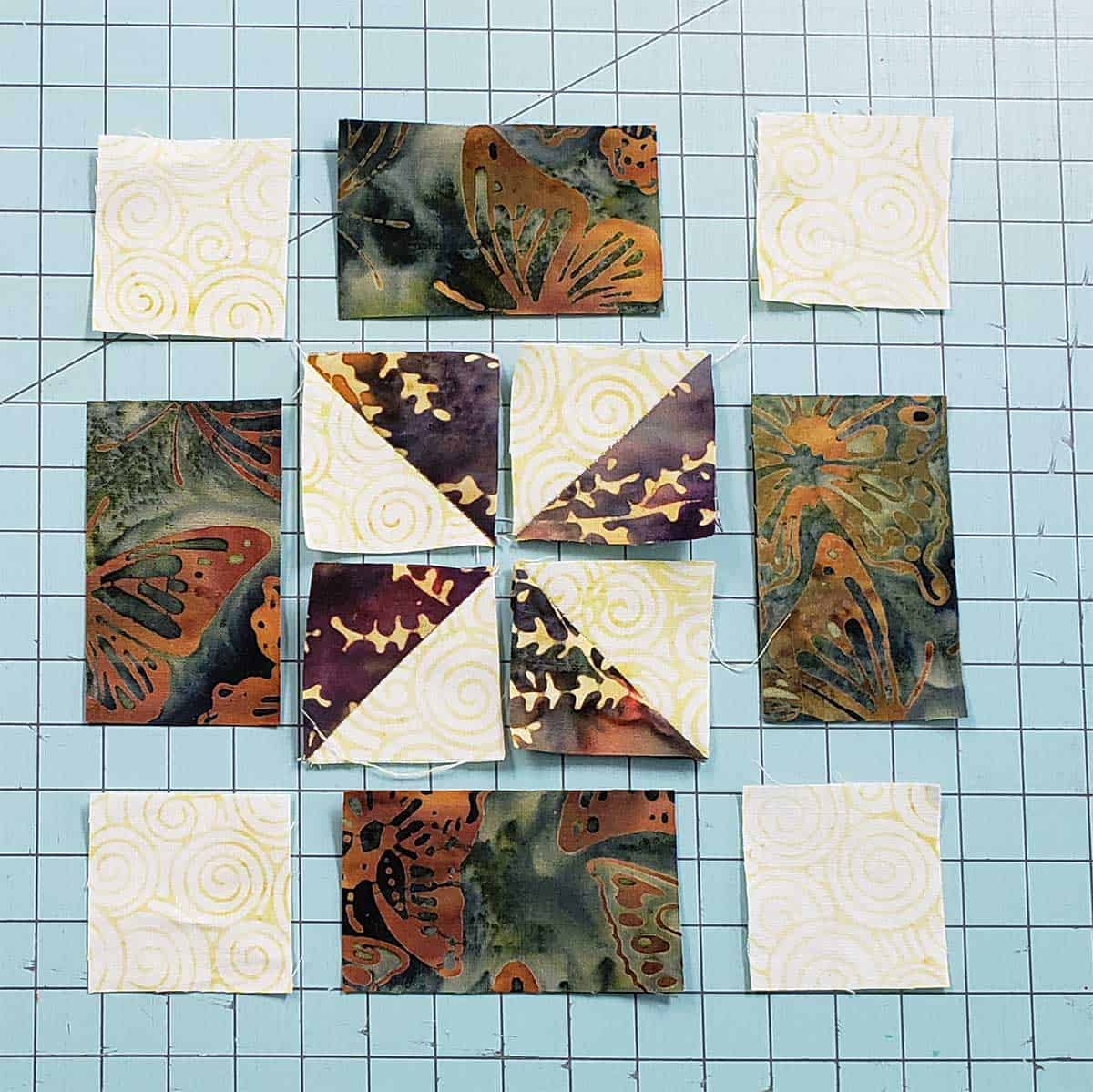 half square pinwheel uneven 9-patch quilt block