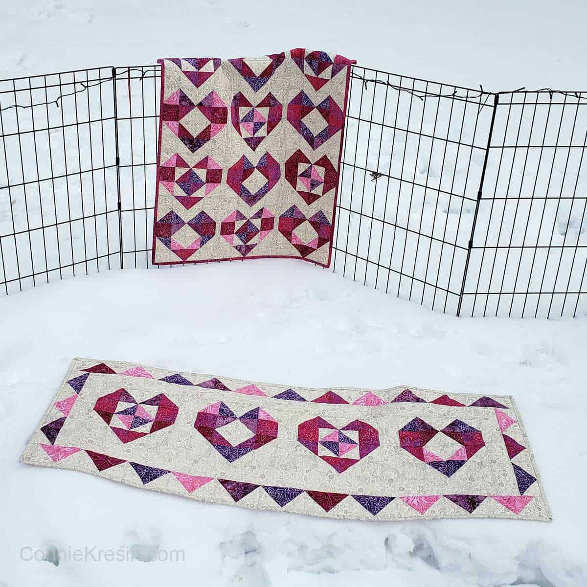 Heart table runner and quilt on fence