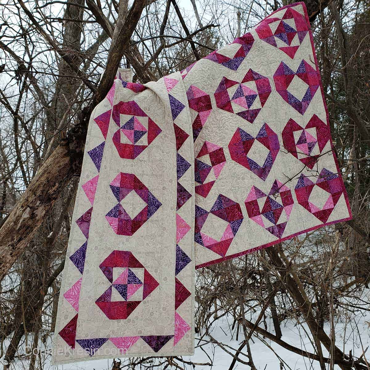 Batik Heart table runner and quilt in the woods