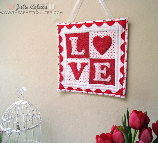 Love quilt block on wall
