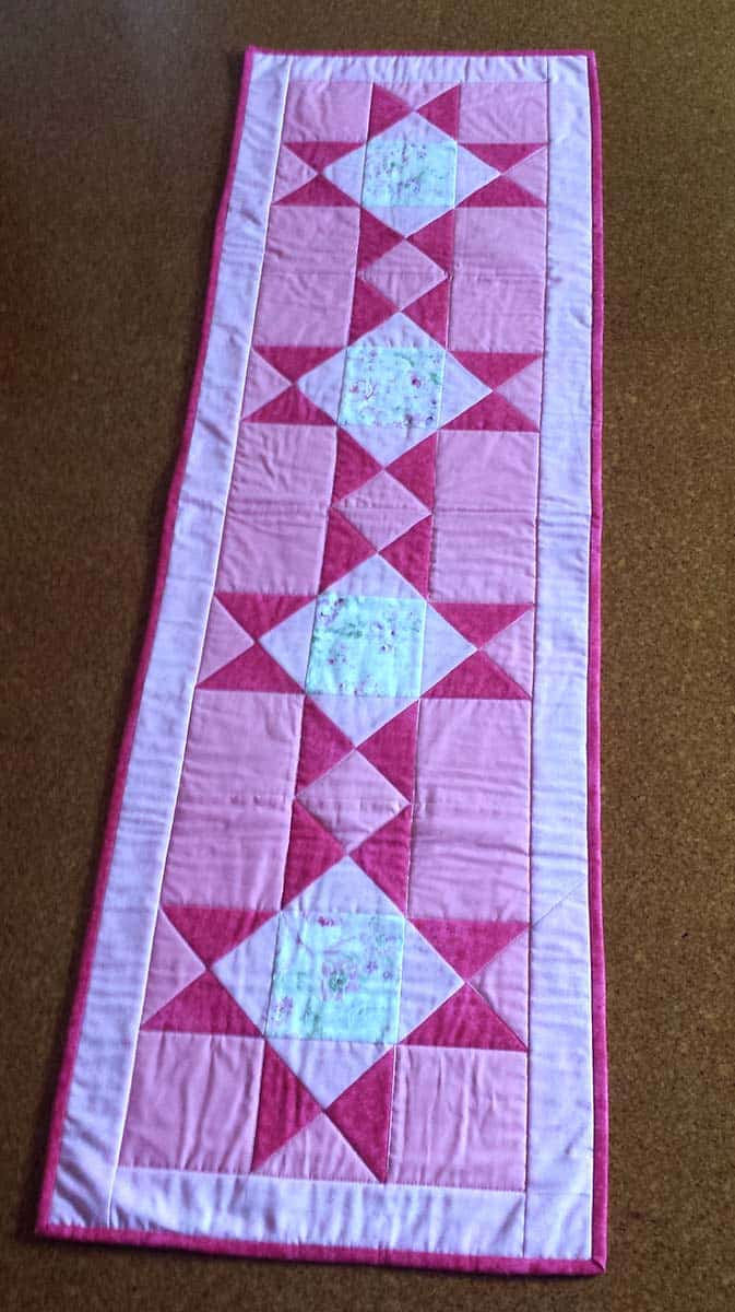 Ohio Star table runner in pinks