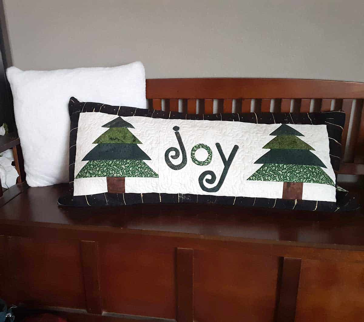 Pillow using the Christmas tree table runner tutorial
