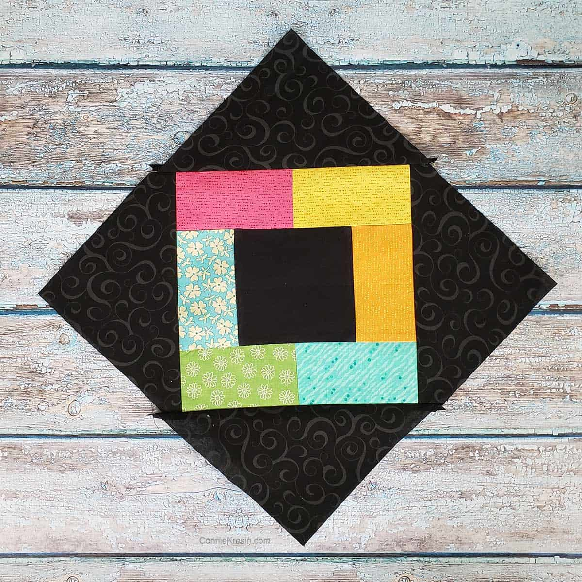 Add the corner triangles to the quilt block