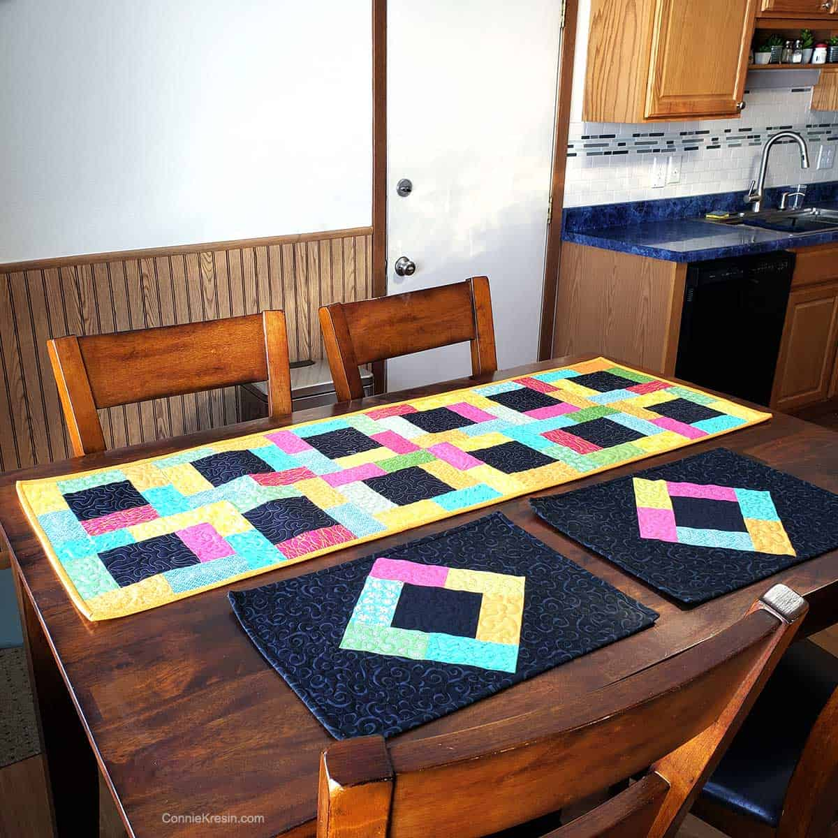 Midnight Glow placemats and runner on kitchen table