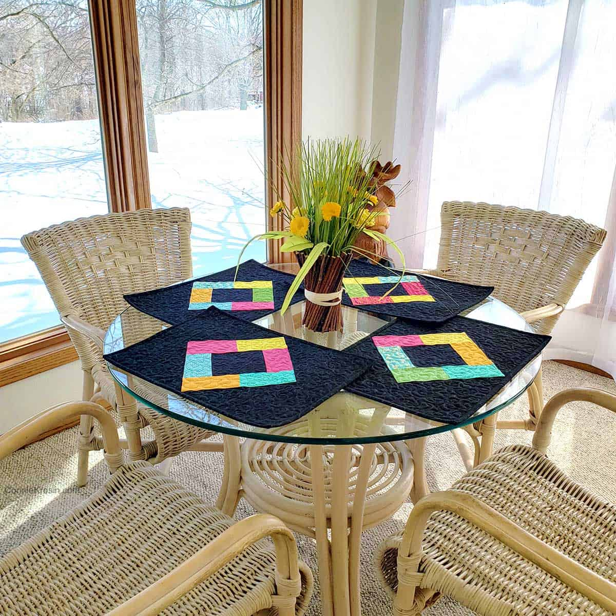 Midnight Glow placemats on wicker table