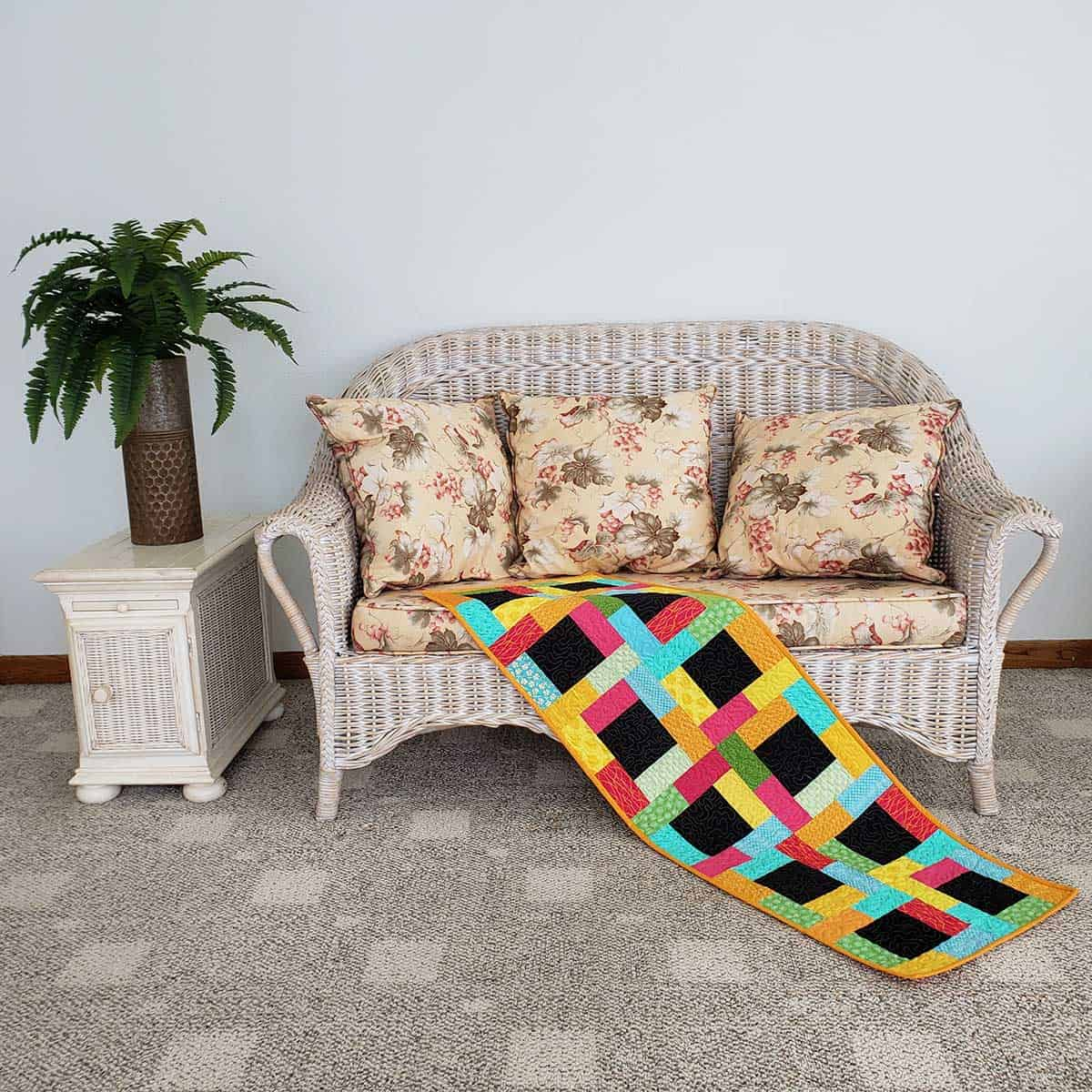 Midnight table runner on chaise lounge