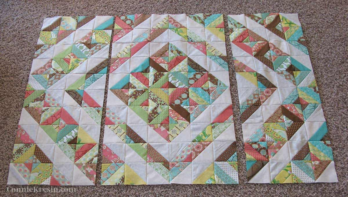 quilt top in three sections before final piecing