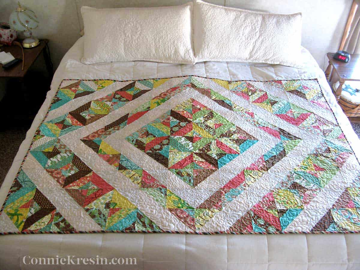Neopolitan quilt on king size bed