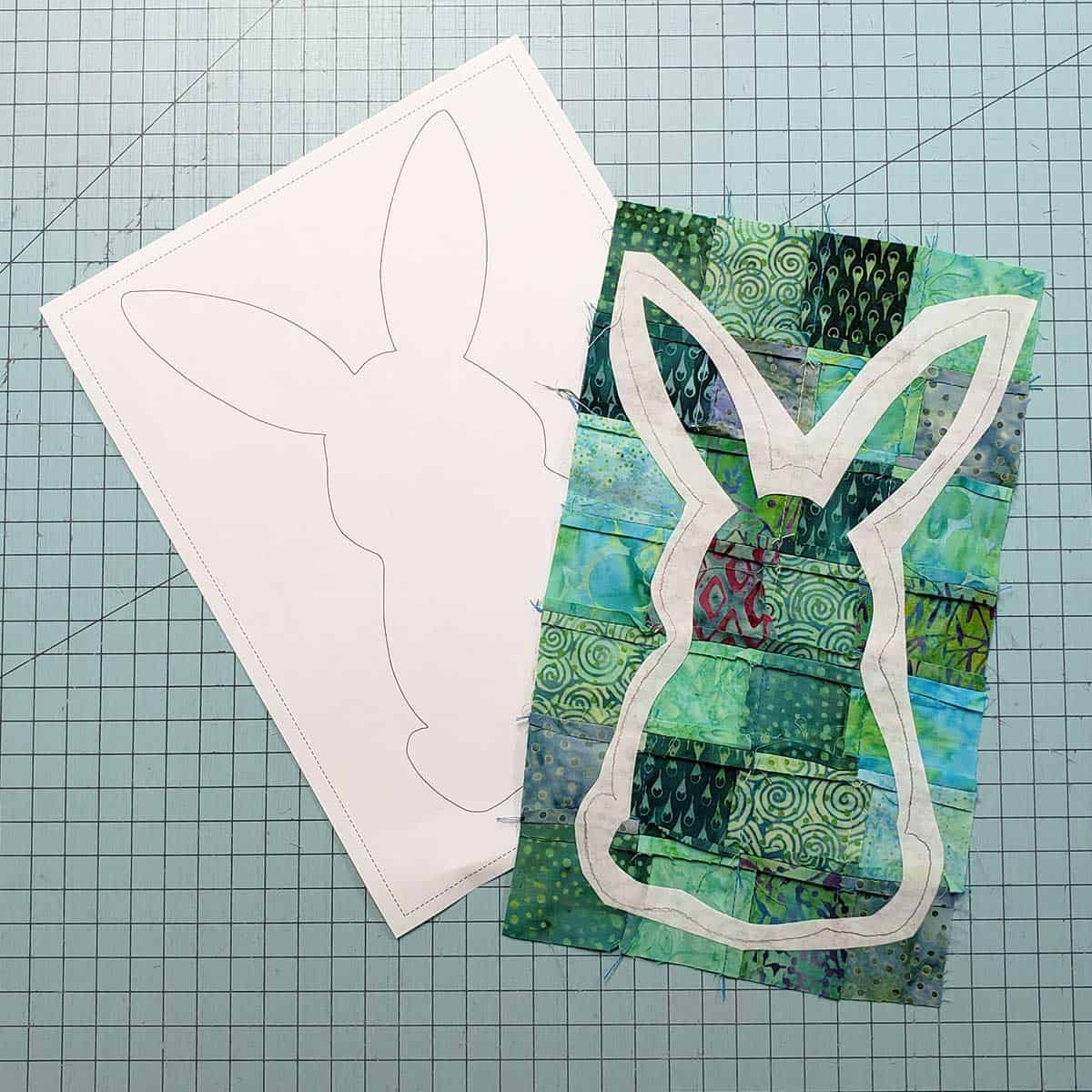 Cut out the center of the fusible iron-on adhesive