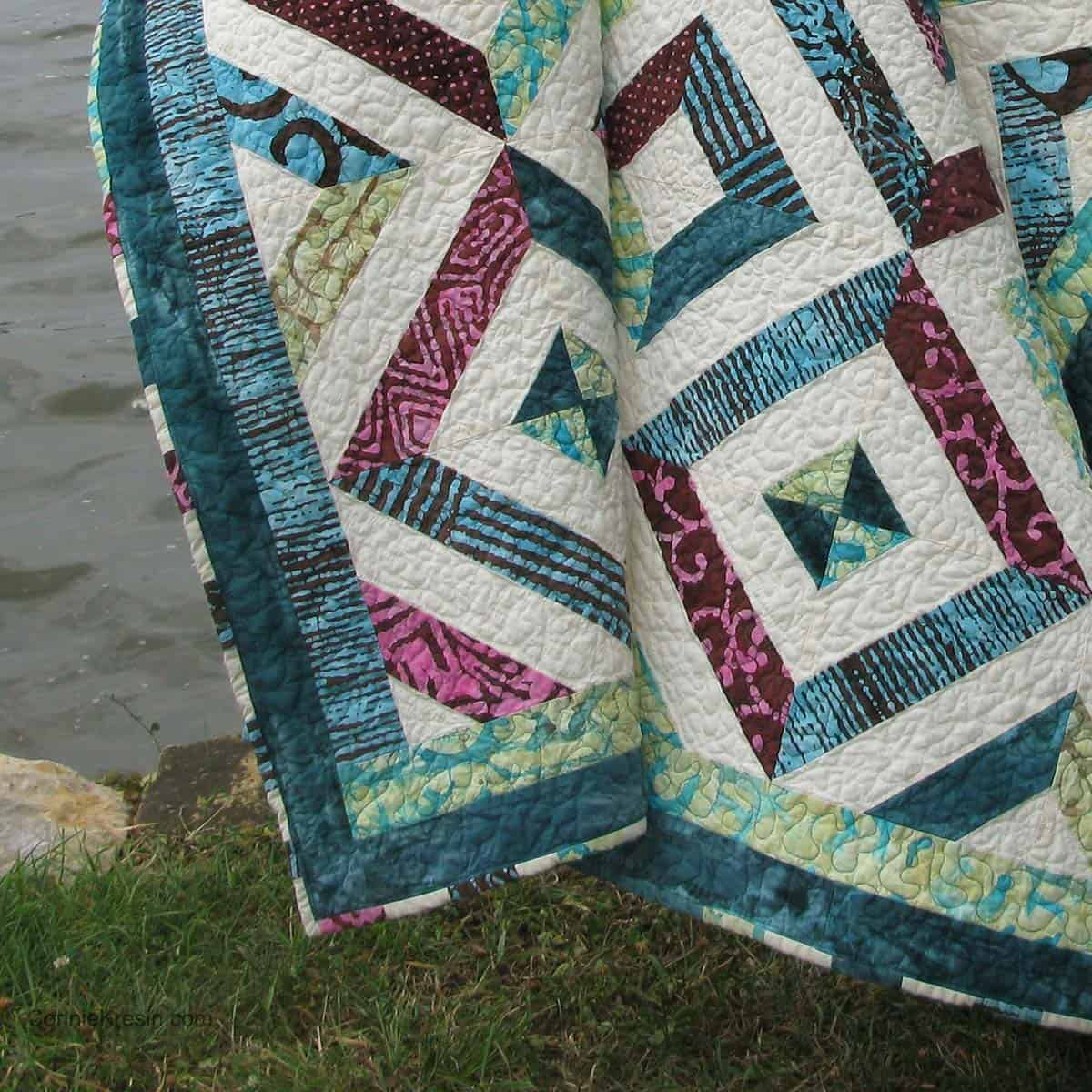Binding on the Petunia Strings quilt