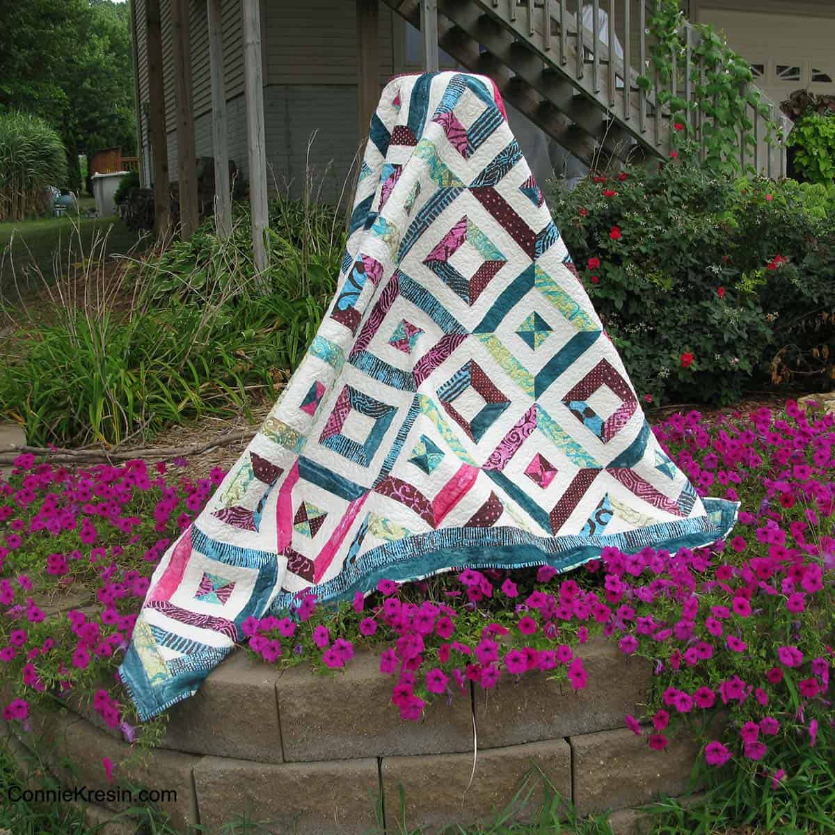 Petunia Strings quilt with flowers
