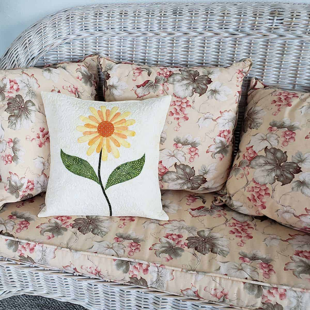 Daisy pillow on the chaise lounge