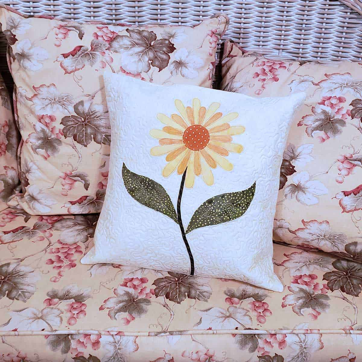 Daisy pillow matches the wicker furniture upholstery