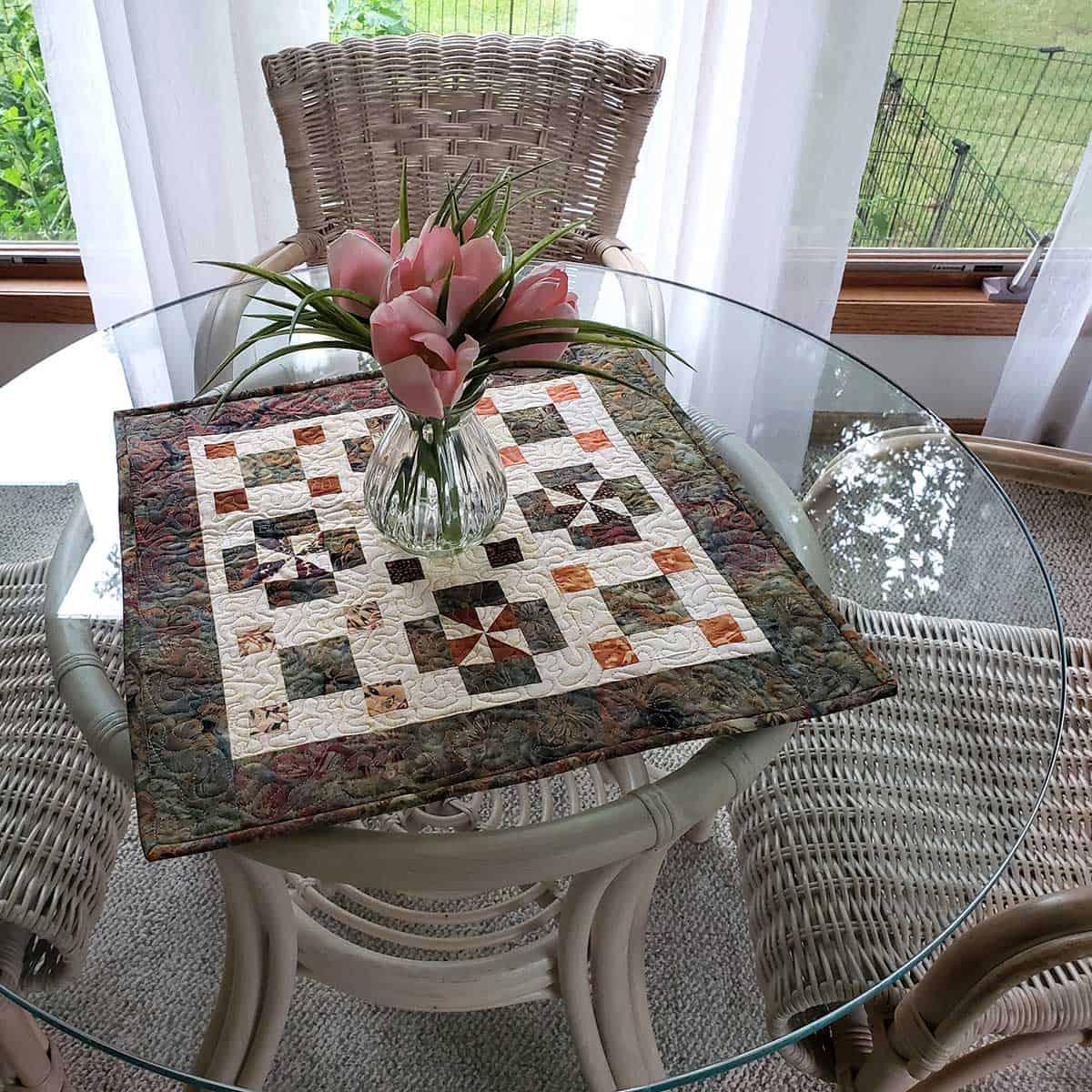 Qurtis mini quilt on table