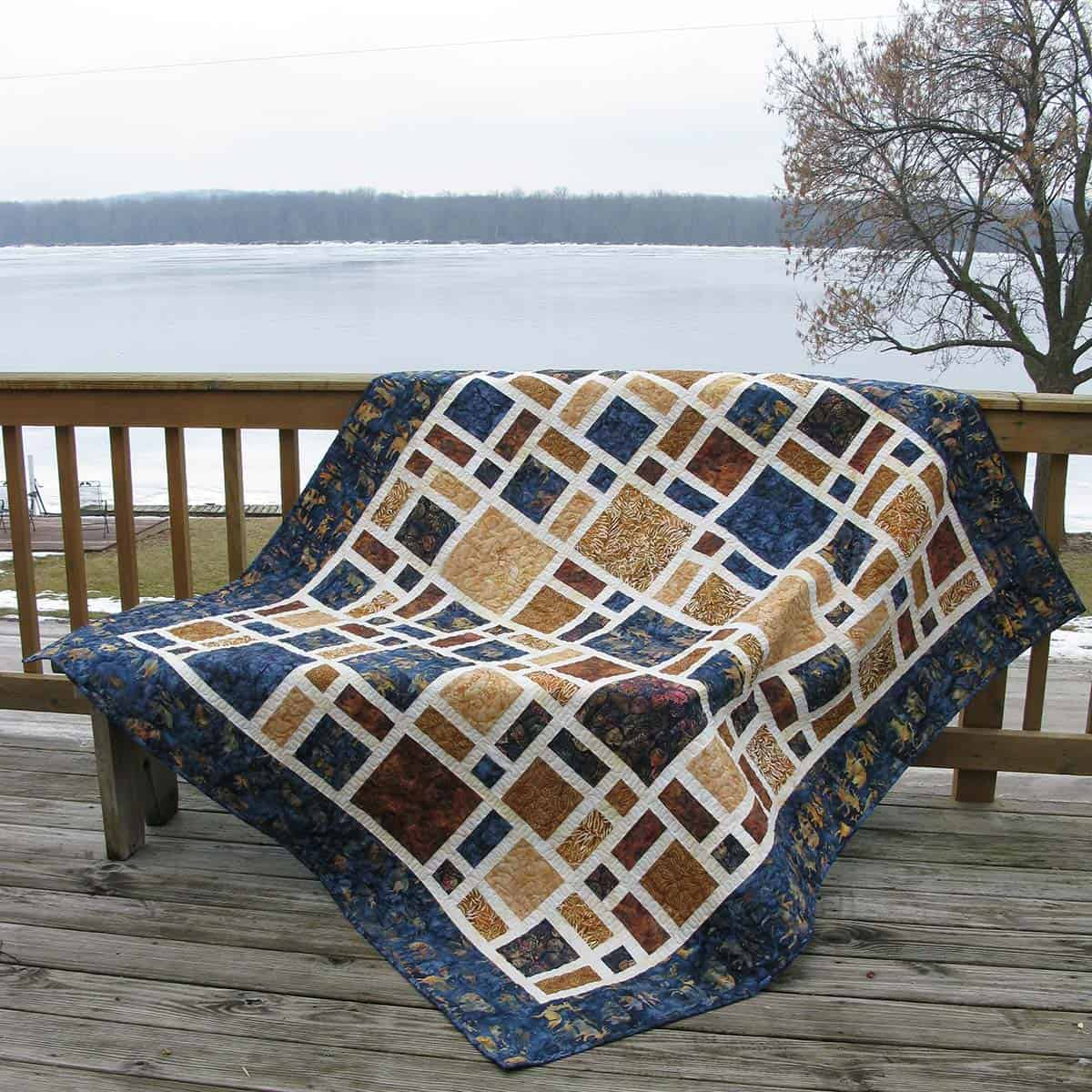 Scattered quilt on deck rail