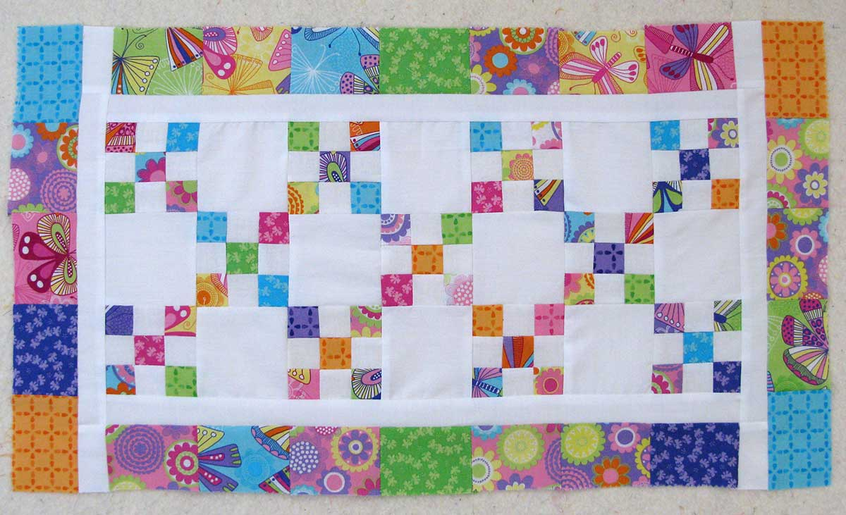 Pieced Scrappy 9 patch table runner