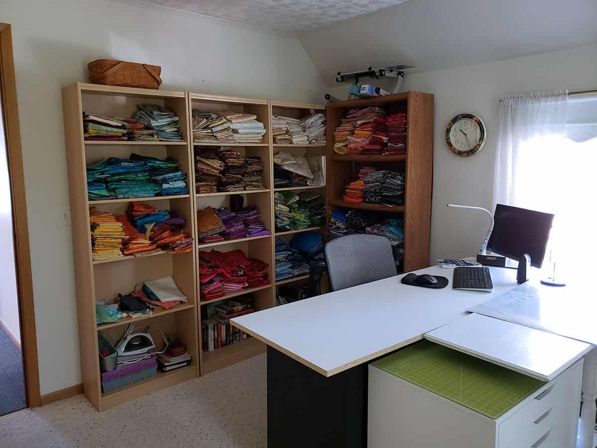Quilt fabrics on shelves