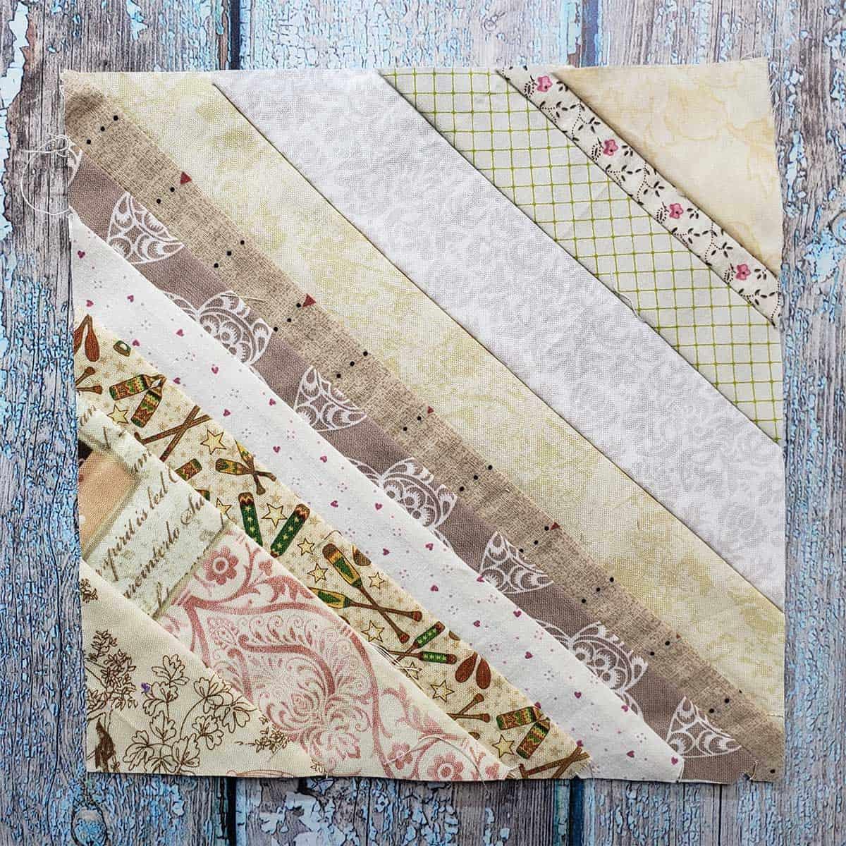 String pieced quilt block