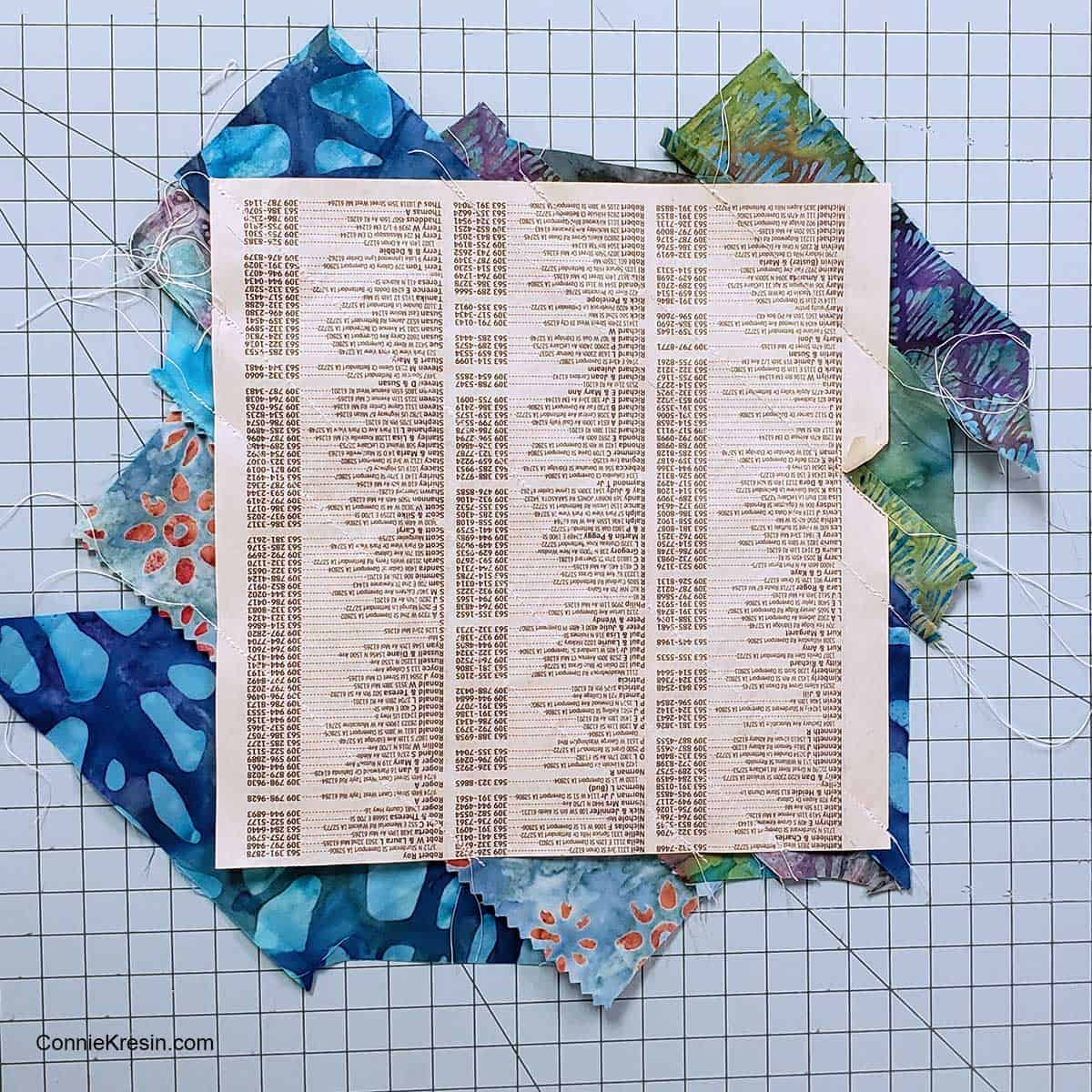 Cover the paper with the fabric strips
