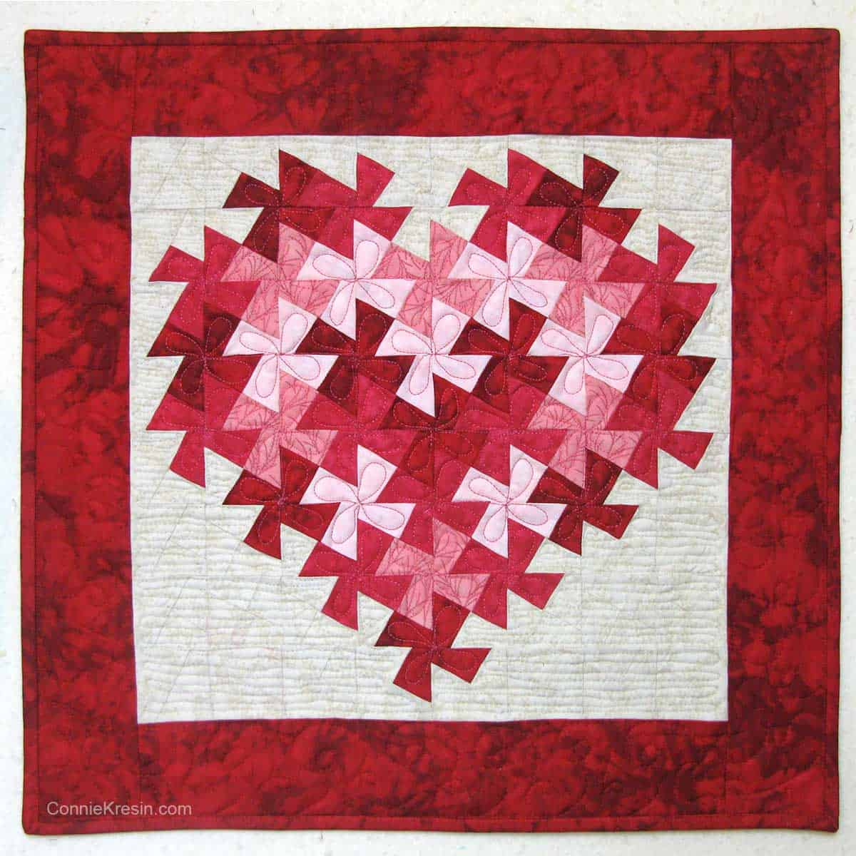 Twisting heart quilt wall hanging